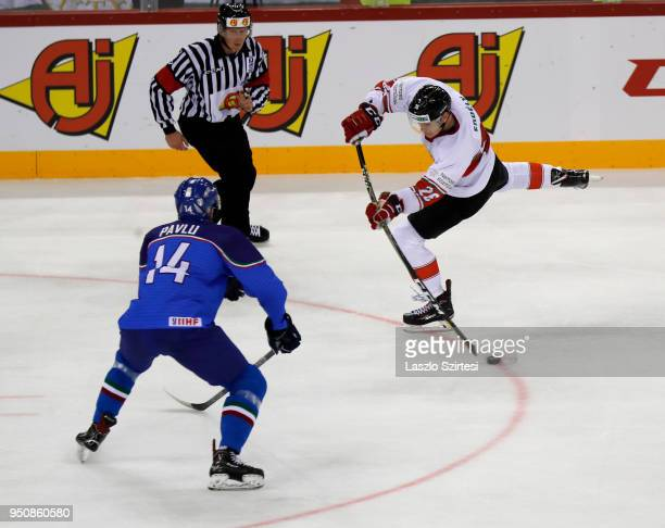 Csanad Erdely of Hungary shoots on goal in front of Jan Pavlu of Italy during the 2018 IIHF Ice Hockey World Championship Division I Group A match...