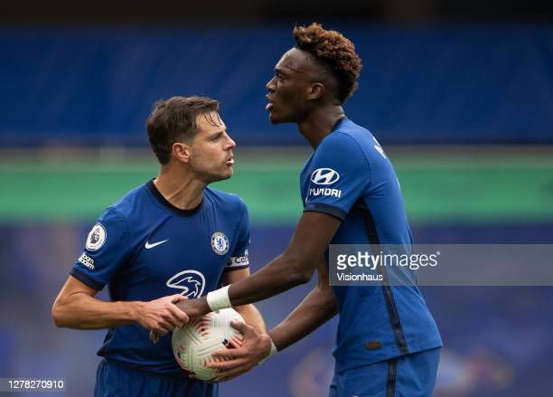 César Azpilicueta and Tammy Abraham discuss who should take Chelsea's second penalty during the Premier League match between Chelsea and Crystal...