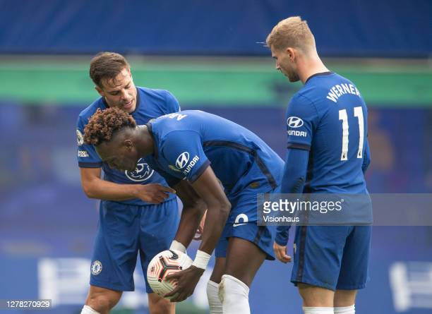César Azpilicueta Tammy Abraham and Timo Werner discuss who should take Chelsea's second penalty during the Premier League match between Chelsea and...