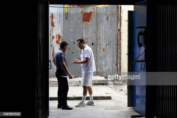 César Funes former Secretary of Youth of El Salvador imprisoned along with former Salvadoran president Antonio Saca talks with a prison agent at La...