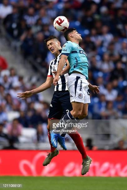 César Montes of Monterrey heads the ball with Germán Berterame of San Luis during the 9th round match between Monterrey and Atletico San Luis as part...