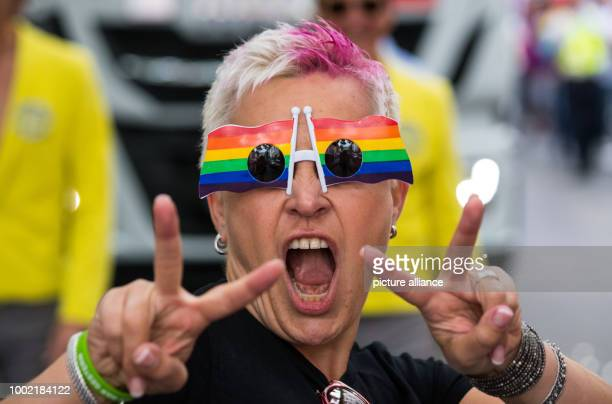 A CSDparticipant wearing glasses in rainbow colours gestures in Frankfurt am Main Germany 15 July 2017 Thousands of lesbians and gays take the...