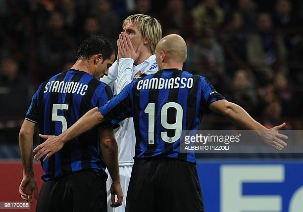 Cska Moscow's Serbian midfielder Milos Krasic reacts after a missed goal in front of Inter Milan's Serbian midfielder Dejan Stankovic and Inter...