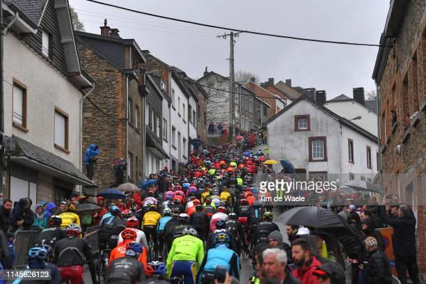 Côte de SaintRoch / Houffalize City / / Peloton / Fans / Public / Landscape / Rain / during the 105th Liege Bastogne Liege 2019 a 256km race from...