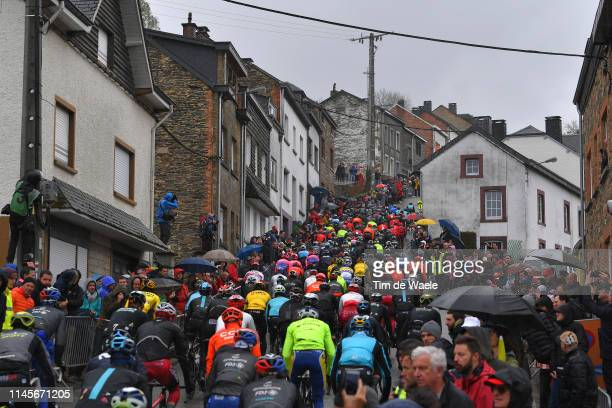 Côte de Saint-Roch / Houffalize City / / Peloton / Fans / Public / Landscape / Rain / during the 105th Liege - Bastogne - Liege 2019 a 256km race...