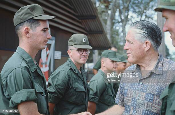 Cu Chi South Vietnam Michigan Governor George Romney talks with troops outside of the chapel at the base camp at Cu Chi the home of the 25th Infantry...