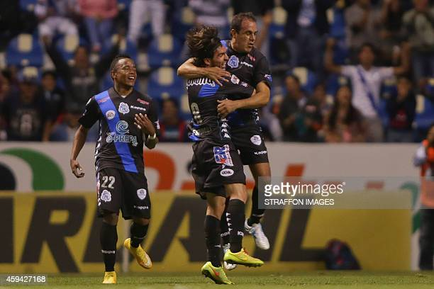 Cuahtemoc Blanco of Puebla celebrates after scoring the second goal of his team with Gerardo Espinoza during a match between Puebla and Santos Laguna...
