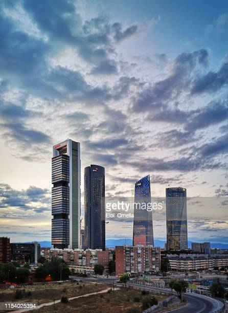 cuatro torres spain financial district skyline at sunset in madrid city - madrid foto e immagini stock