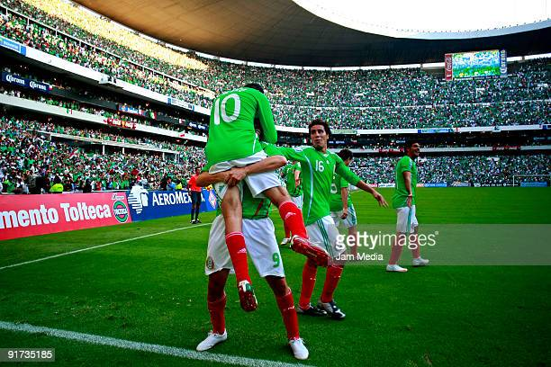Cuauhtemoc Blanco and Guillermo Franco of Mexico celebrate scored goal during a match against El Salvador as part of the FIFA 2010 World Cup...