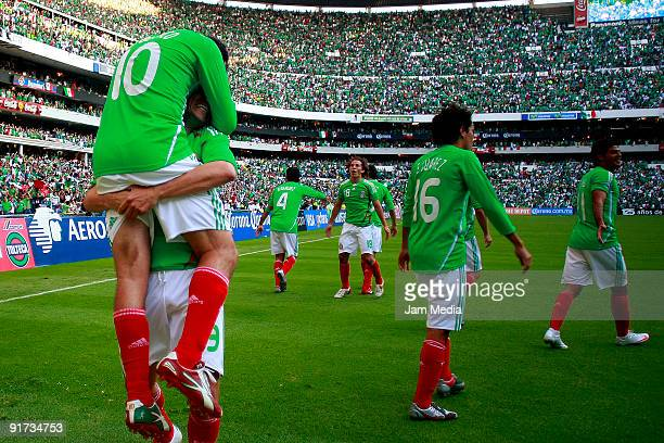 Cuauhtemoc Blanco and Guillermo Franco of Mexico celebrate scored goal during their FIFA 2010 World Cup Qualifying match at the Azteca Stadium on...