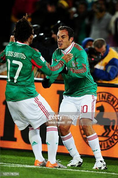 Cuauhtemoc Blanco celebrates scoring a penalty for his team's second goal with team mate Giovani Dos Santos during the 2010 FIFA World Cup South...