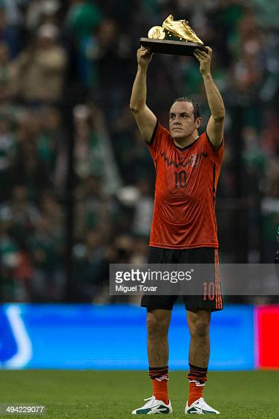 Cuauhtemoc Blanco hold up a trophy in his national soccer team farewell ceremony during a FIFA friendly match between Mexico and Israel ahead the...