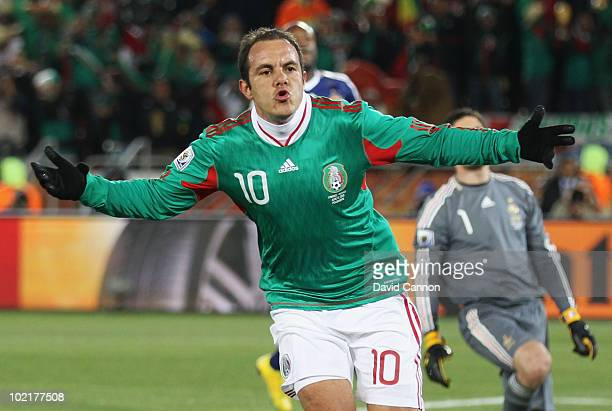 Cuauhtemoc Blanco of Mexico celebrates after scoring a penalty during the 2010 FIFA World Cup South Africa Group A match between France and Mexico at...