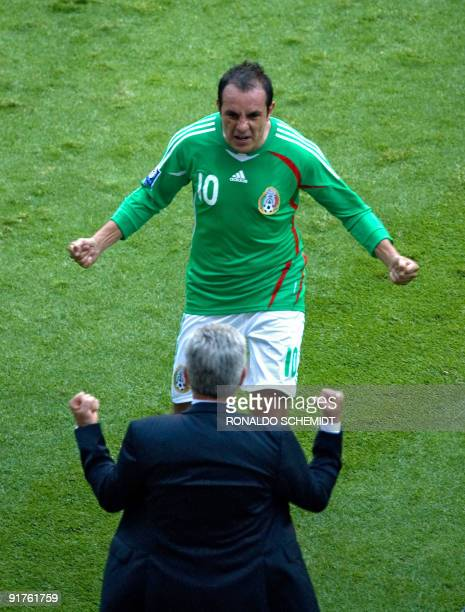 Cuauhtemoc Blanco of Mexico celebrates his goal against El Salvador with Coach Javier Aguirre during their FIFA World Cup South Africa2010 qualifier...