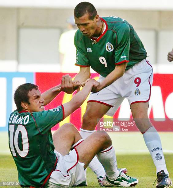 Cuauhtemoc Blanco of Mexico celebrates with his team mate Jared Borgetti after getting a penalty kick during the FIFA World Cup Korea/Japan Group G...
