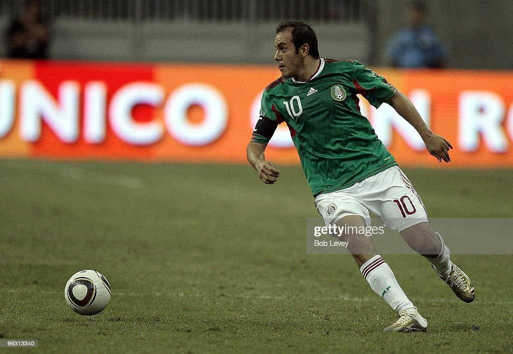 Cuauhtemoc Blanco #10 of Mexico controls the ball against Angola at Reliant Stadium on May 13, 2010 in Houston, Texas.