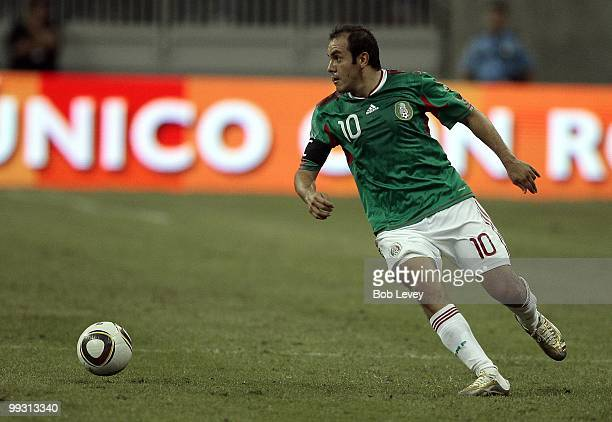 Cuauhtemoc Blanco of Mexico controls the ball against Angola at Reliant Stadium on May 13 2010 in Houston Texas