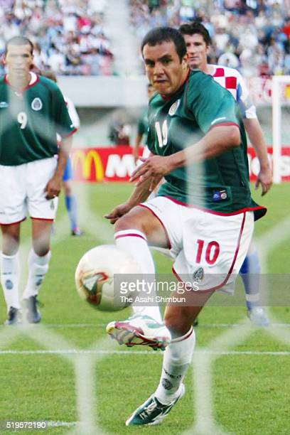 Cuauhtemoc Blanco of Mexico coverts the penalty to score his team's first goal during the FIFA World Cup Korea/Japan Group G match between Croatia...
