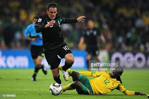 Cuauhtemoc Blanco of Mexico is tackled by Reneilwe Letsholonyane of South Africa during the 2010 FIFA World Cup South Africa Group A match between...