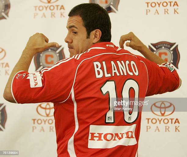 Cuauhtemoc Blanco of Mexico points to his new jersey after being introduced as the newest member of the Chicago Fire at a news conference in Chicago...