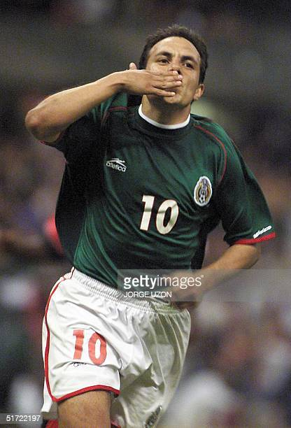 Cuauhtemoc Blanco of Mexico throws a kiss in celebration of his third goal during the game against Tridad and Tobago for the World Cup tryouts in...