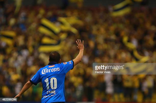 Cuauhtemoc Blanco of Puebla says goodbye during a match between America and Puebla as part of 3rd round Clausura 2015 Liga MX at Azteca Stadium on...