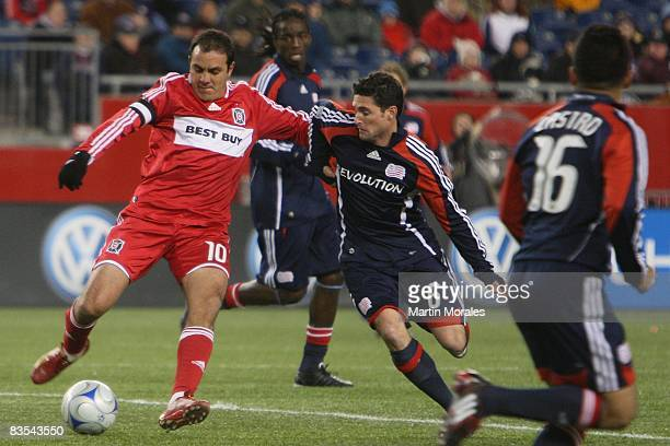 Cuauhtemoc Blanco of the Chicago Fire and Jay Heaps of the New England Revolution battle for the ball during the game played at Gillette Stadium on...