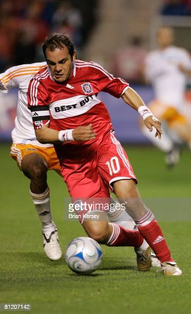Cuauhtemoc Blanco of the Chicago Fire brings the ball up the field against the Houston Dynamo during the second half at Toyota Park on May 17, 2008...