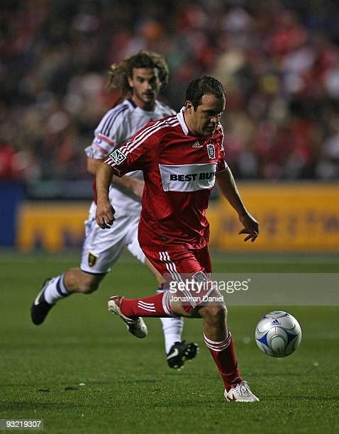 Cuauhtemoc Blanco of the Chicago Fire brings the ball upfield in front of Kyle Beckerman of Real Salt Lake during the MLS Eastern Conference...