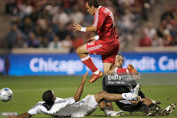 Cuauhtemoc Blanco of the Chicago Fire leaps over Troy Roberts and goalkeeper Josh Wicks of the Los Angeles Galaxy on his way to a goal during the...