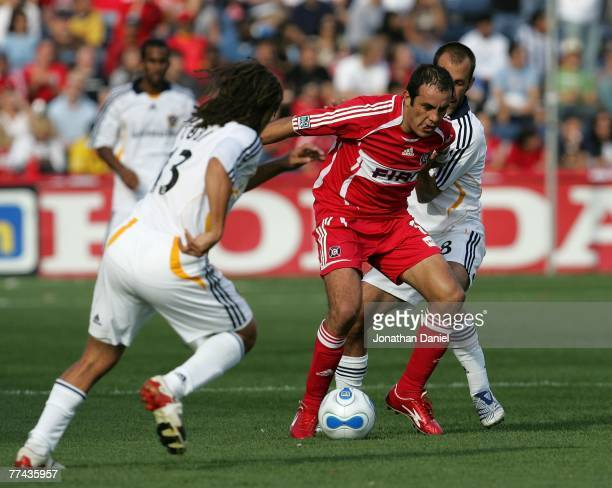 Cuauhtemoc Blanco of the Chicago Fire splits defenders Cobi Jones and Peter Vagenas of the Los Angeles Galaxy on October 21, 2007 at Toyota Park in...