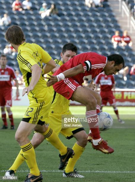 Cuauhtemoc Blanco of the Chicago Fire tries to keep the ball away from Eddie Gavin and Danny O'Rourke of the Columbus Crew during the first half at...