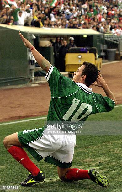 Cuauhtemoc Blanco of the Mexican national soccer team celebrates after scoring Mexico's second goal against the national soccer team of the Islamic...