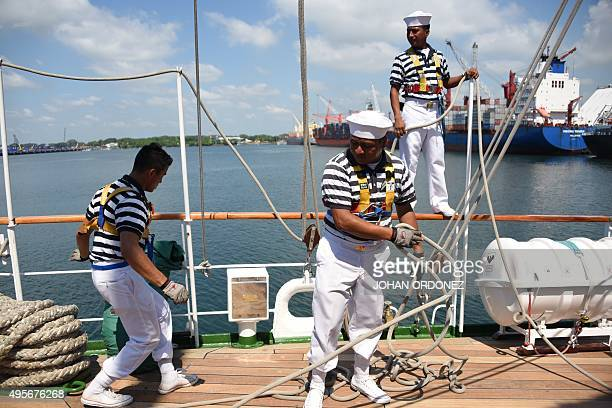 ARM Cuauhtemoc Mexican Navy training ship sailors work on the deck during the mooring maneuvers upon arrival at the Port of Quetzal 110 km south of...