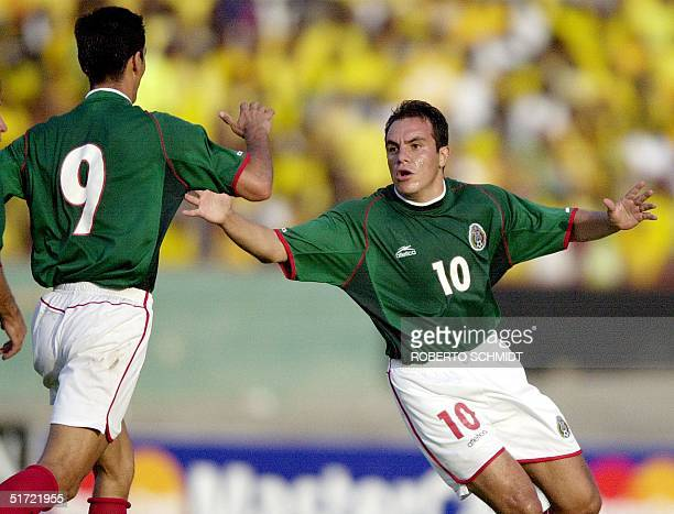 Cuautehmoc Blanco of Mexico celebrates scoring of his two goals with teammate Jared Borgetti of Mexico at the National Stadium in Kingston Jamaica 02...
