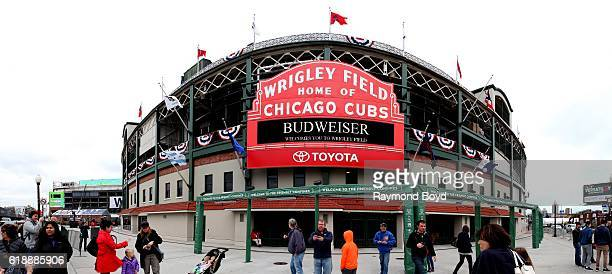 Cub fans gather under the Wrigley Field marquee to celebrate to Cubs' World Series birth at Wrigley Field home of the Chicago Cubs baseball team in...