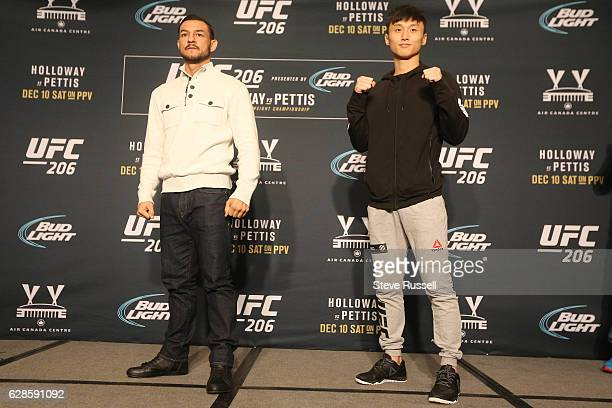 TORONTO ON DECEMBER 8 Cub Swanson and Doo Ho Choi pose during UFC 206 Media day All the fighters on the card make themselves available to the media...
