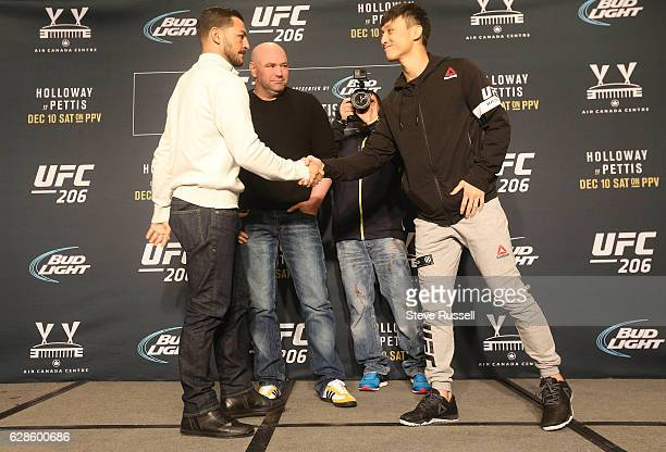 TORONTO ON DECEMBER 8 Cub Swanson and Doo Ho Choi shake hands in front of Dana White during UFC 206 Media day All the fighters on the card make...