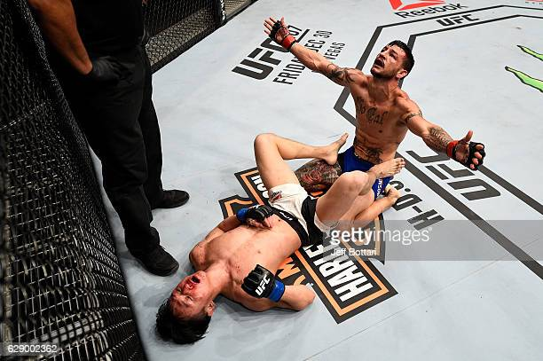 Cub Swanson and Dooho Choi of South Korea react after the conclusion of their threeround featherweight bout during the UFC 206 event inside the Air...