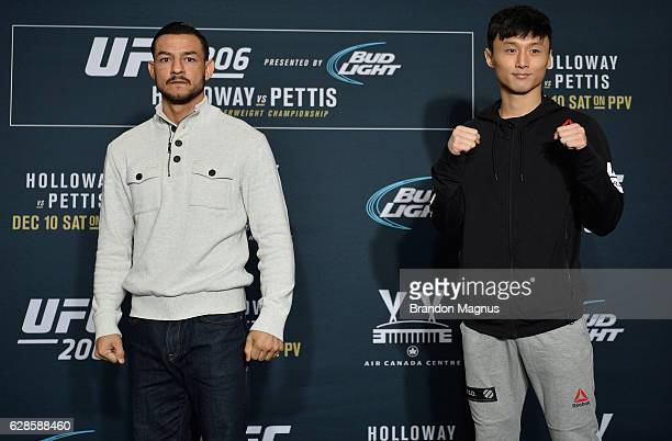 Cub Swanson and Dooho Choi pose for a picture during the UFC 206 Ultimate Media Day event inside the Westin Harbour Castle Hotel on December 8, 2016...