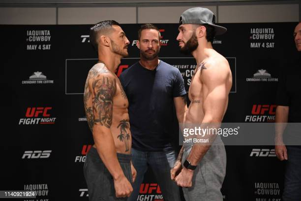 Cub Swanson and Shane Burgos face off during the UFC Fight Night weighin at Andaz Ottawa Byward Market on May 3 2019 in Ottawa Ontario Canada