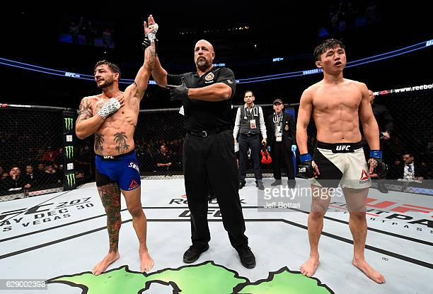 Cub Swanson celebrates his unanimousdecision victory over Dooho Choi of South Korea in their featherweight bout during the UFC 206 event inside the...