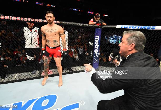 Cub Swanson is introduced in the Octagon by Bruce Buffer prior to his featherweight bout against Artem Lobov during the UFC Fight Night event at...