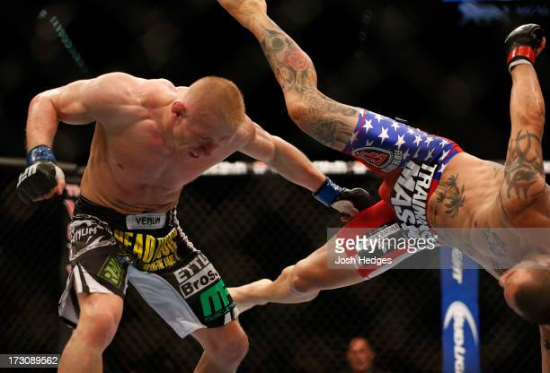 Cub Swanson kicks Dennis Siver in their featherweight fight during the UFC 162 event inside the MGM Grand Garden Arena on July 6, 2013 in Las Vegas,...