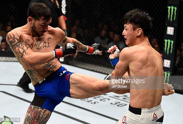 Cub Swanson kicks Dooho Choi of South Korea in their featherweight bout during the UFC 206 event inside the Air Canada Centre on December 10 2016 in...