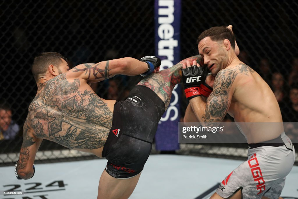 Cub Swanson kicks Frankie Edgar in their featherweight fight during the UFC Fight Night event at the Boardwalk Hall on April 21, 2018 in Atlantic City, New Jersey.