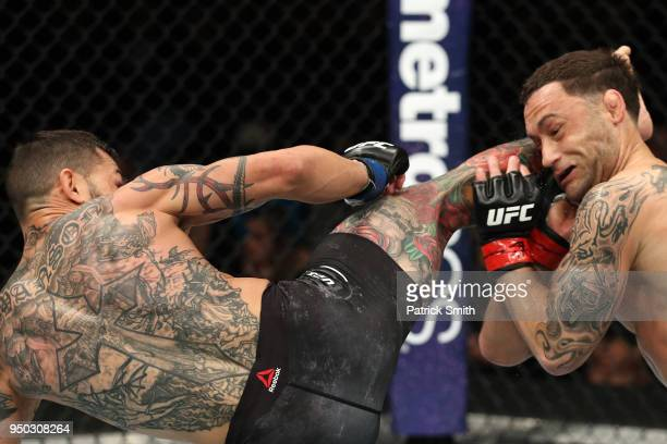 Cub Swanson kicks Frankie Edgar in their featherweight fight during the UFC Fight Night event at the Boardwalk Hall on April 21 2018 in Atlantic City...