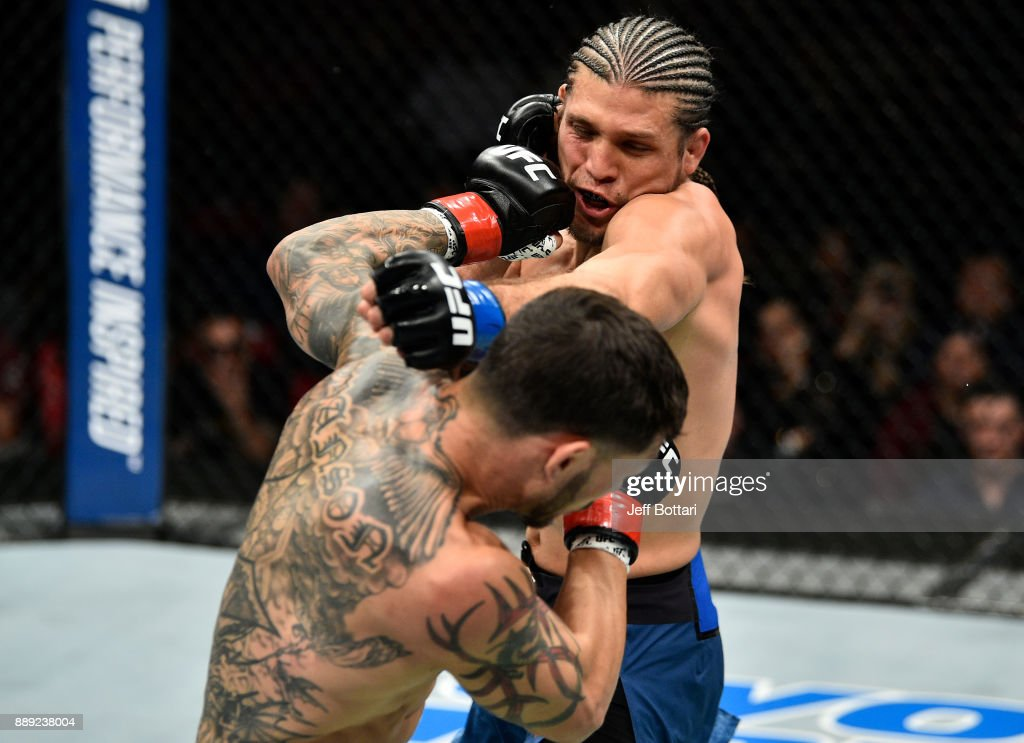 Cub Swanson punches Brian Ortega in their featherweight bout during the UFC Fight Night event inside Save Mart Center on December 9, 2017 in Fresno, California.