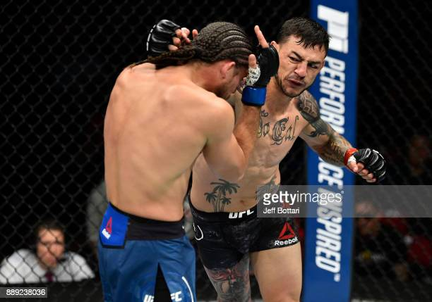 Cub Swanson punches Brian Ortega in their featherweight bout during the UFC Fight Night event inside Save Mart Center on December 9 2017 in Fresno...