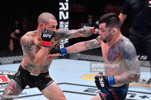 Cub Swanson punches Daniel Pineda in their featherweight bout during the UFC 256 event at UFC APEX on December 12, 2020 in Las Vegas, Nevada.